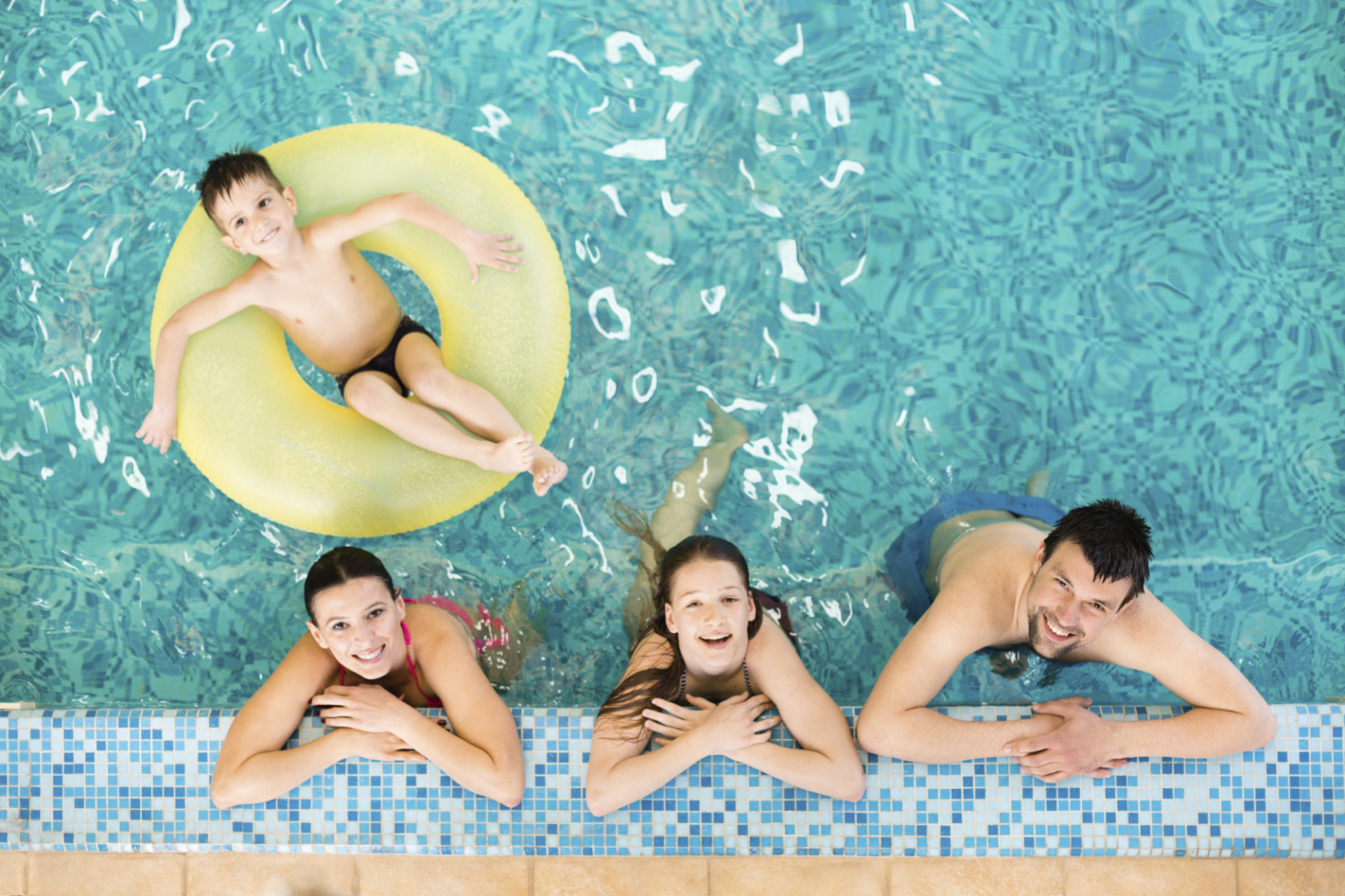 Family in the swimming pool